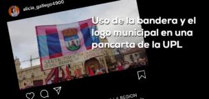 Uso de la bandera y el logo municipal en una pancarta de la UPL